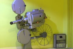 An ancient projector of old films, of cinema of other times. Movie for children and adults stock images