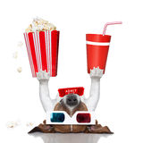 Movie cinema dog. Movie dog up side down holding popcorn and coke Royalty Free Stock Images