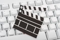 Movie clap board and keyboard Stock Images