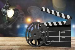 Movie clapper board on wooden background. Movie clap clapper take action entertainment blue background Stock Photo