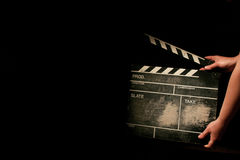 Movie clapper. Old movie clapper on black Royalty Free Stock Image