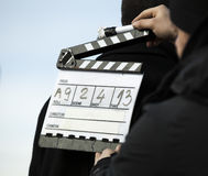 Movie clapper. Assistant director with clapper board in action Royalty Free Stock Images