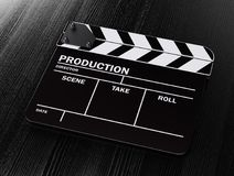 Movie clapper board. On black wood table background. Cinema concept. 3d rendering illustration Stock Photography