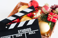 Movie clapper board and christmas decoration Stock Photos