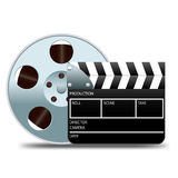 Movie clapper board and film reel. On a white Royalty Free Stock Photography