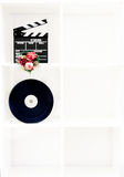 Movie clapper board, film reel and christmas decoration on verti Stock Photo