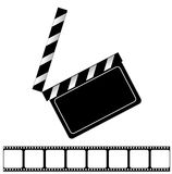 Movie clapper board and filmstrip Royalty Free Stock Images