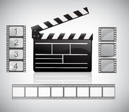 Movie clapper board and filmstrip Stock Photo
