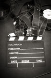 Movie clapper board and filmstrip selective focus Royalty Free Stock Image