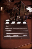 Movie clapper board and filmstrip selective focus Stock Photography