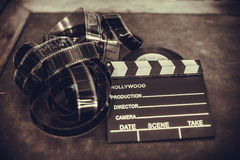Movie clapper board and filmstrip selective focus Royalty Free Stock Images
