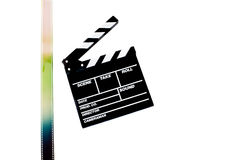 Movie clapper board with filmstrip on white Royalty Free Stock Image