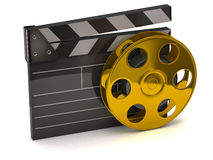 Movie clapper board and golden film reel. 3d illustration of movie clapper board and golden film reel Royalty Free Stock Photography