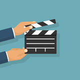 Movie clapper board hold in hand. Man. Isolated on background. Open clapperboard. Cinematography concept. Template for the director`s instructions, the producer Stock Images