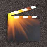 Movie clapper board with light spot Stock Images