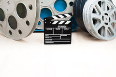 Movie clapper board and 35 mm cinema reels Stock Image