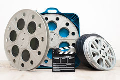 Movie clapper board and 35 mm cinema reels Royalty Free Stock Photo