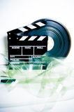 Movie clapper board and 35 mm film reel Royalty Free Stock Images