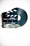Movie clapper board and 35 mm film reel Royalty Free Stock Image