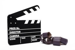 Movie clapper board and 35mm film Royalty Free Stock Images
