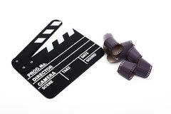 Movie clapper board and 35mm film Royalty Free Stock Photos