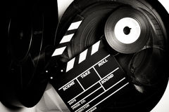 Movie clapper board on 35 mm movie reels Stock Photo