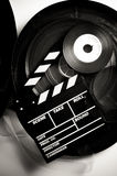 Movie clapper board on 35 mm movie reels Royalty Free Stock Photos