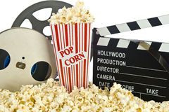 Movie Clapper Board in popcorn with film reel. Isolated on white Stock Photography