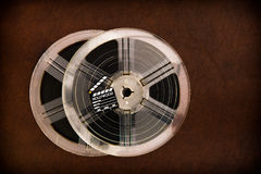 Movie clapper board and transparent film reels Stock Photos