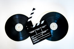 Movie clapper board on two 35 mm film reels Stock Photos
