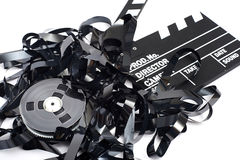 Movie clapper board with video tape Royalty Free Stock Images