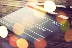 Movie clapper board on wooden background. Movie clap clapper take action entertainment blue background Royalty Free Stock Images