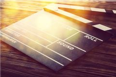 Movie clapper board on wooden background. Movie clap clapper take action entertainment blue background Royalty Free Stock Photos