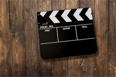 Movie clapper board on wooden background. Movie clap clapper take action entertainment blue background Royalty Free Stock Photography