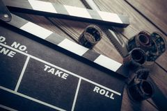 Movie clapper board on wooden background. Movie clap clapper take action entertainment blue background Royalty Free Stock Image