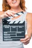 Movie clapper in female hands in focus Stock Photos