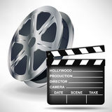 Movie clapper with film reel. Movie clapper and film reel Stock Photography