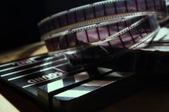 Movie clapper and film reel on a background royalty free stock photo