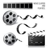 Movie clapper and film reel Royalty Free Stock Image