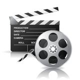 Movie clapper and film reel Royalty Free Stock Images