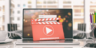 Movie clapper and a laptop in an office. 3d illustration Stock Photography