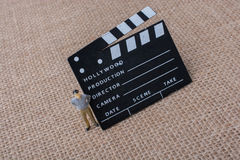 Movie  clapper and a man figurine Royalty Free Stock Photo