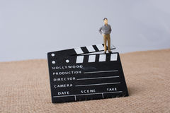 Movie  clapper and a man figurine Royalty Free Stock Photos