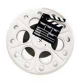 Movie clapper on 35 mm cinema film reel isolated Royalty Free Stock Photography