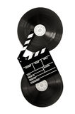 Movie clapper on 35 mm cinema film reels isolated vertical Stock Photo