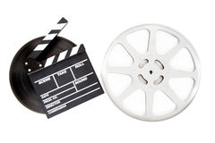 Movie clapper on 35 mm cinema film reels isolated. On white background royalty free stock image