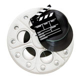Movie clapper on 35 mm cinema film reels isolated Royalty Free Stock Photo
