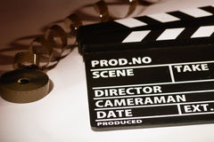 Movie clapper with 16 mm film. Royalty Free Stock Images