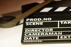 Movie clapper with 16 mm film. Preparations for shooting movie Royalty Free Stock Image
