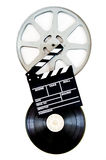 Movie clapper on 35 mm film reels isolated vertical Stock Image